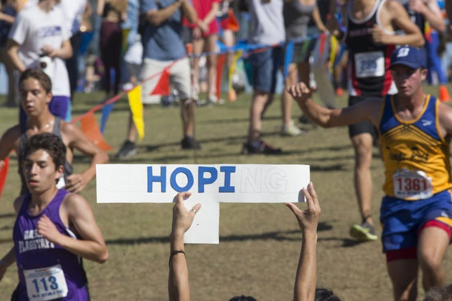 A fan holds a Hopi sign during the Division 4 Boys AIA State Cross Country State Championships, November 5, 2016, at the Cave Creek Golf Course, 15202 N. 19th Ave., Phoenix.