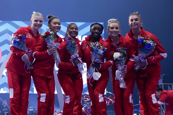 The women's Olympic team pose for a photo during the U.S. Olympic Team Trials - Gymnastics competition at The Dome at America's Center.