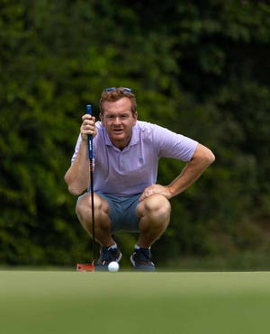 John DiGiacomo lines up a putt en route to capturing his first Lebanon County Amateur Golf title since 2001 on Sunday at Pine Meadows Golf Complex. DiGiacomo shot a final round 3-under 69 to grab the victory.