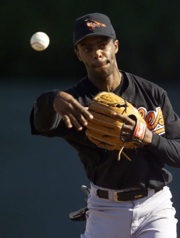 Baltimore Orioles second baseman Delino DeShields flips the ball during a drill at training camp Thursday, Feb. 24, 2000, in Fort Lauderdale, Florida.