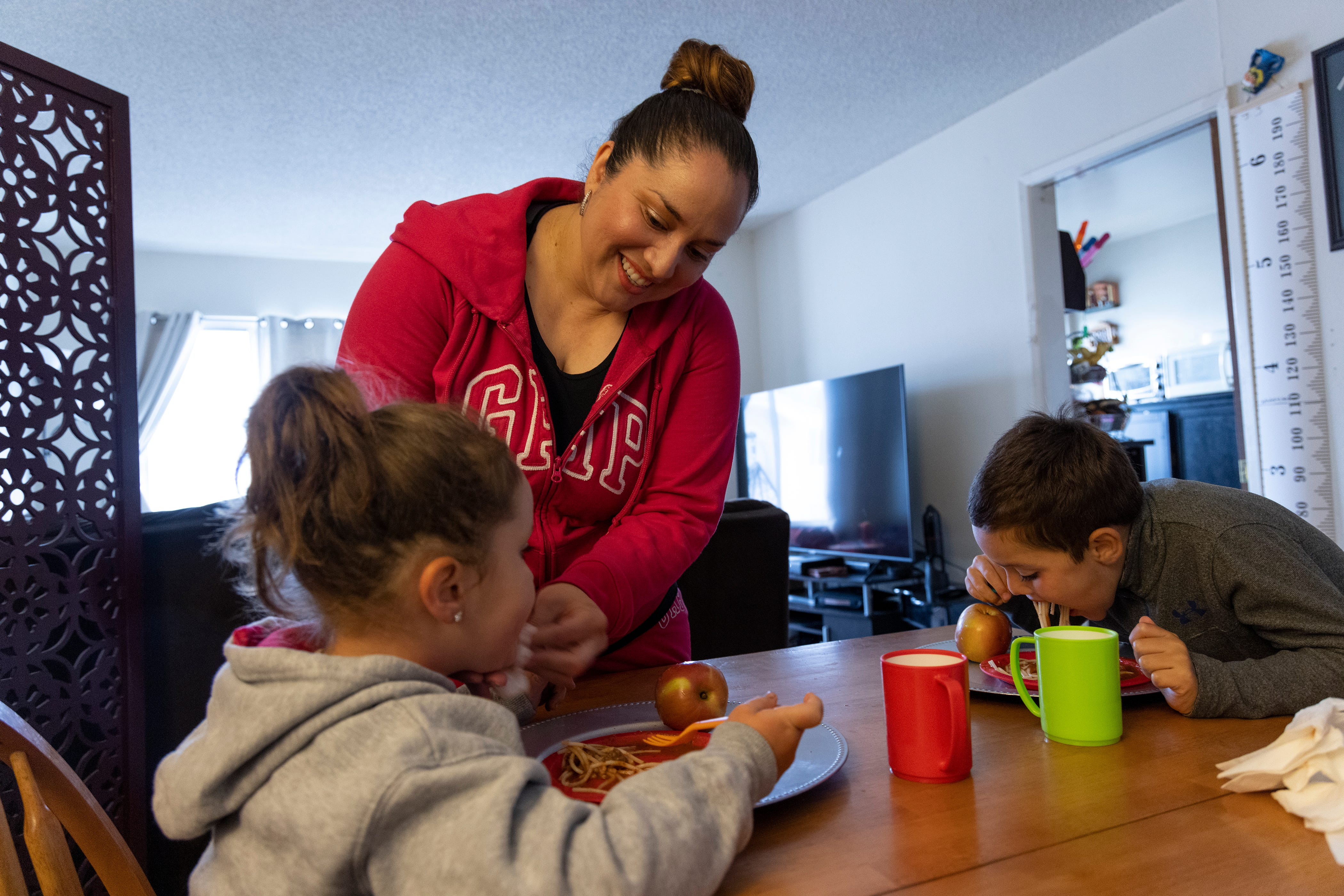 Lily Marquez, a married mother of two, makes dinner for her family in San Francisco on June 25.