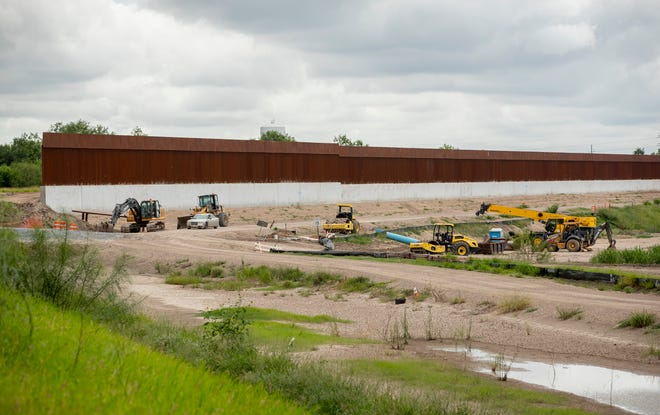 Work continues on the border wall in Mission on Tuesday.