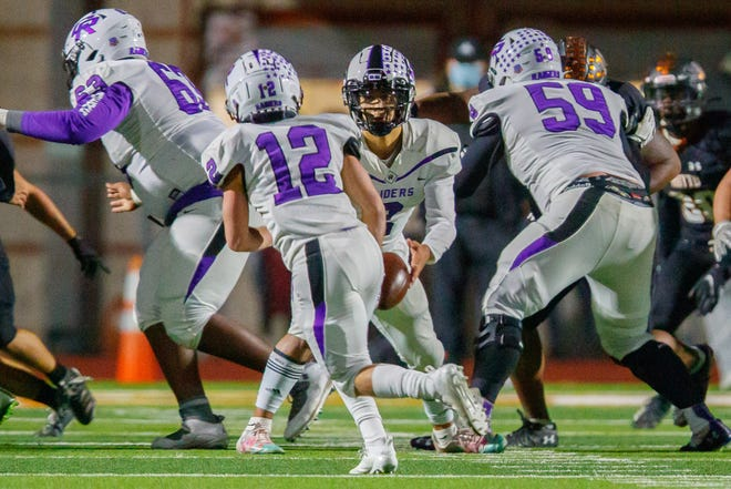Cedar Ridge Joshua Wollard, right, pass blocks in a game against Hutto last season. Wollard is the only returning starter up front for the Raiders, and he garnered valuable experience a year ago while starting every game for a team that averaged 28 points a game.