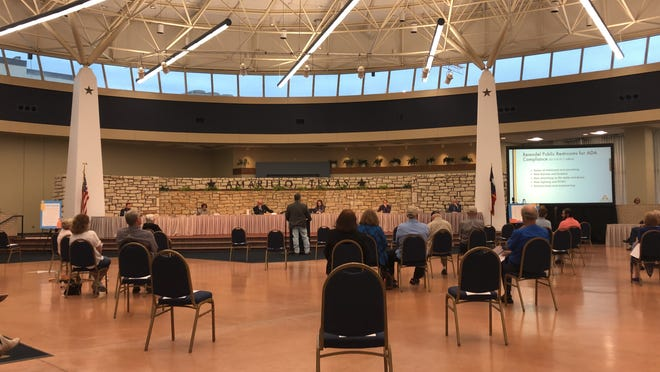 Community members participate in the city of Amarillo's community solutions meeting surrounding the future of City Hall.