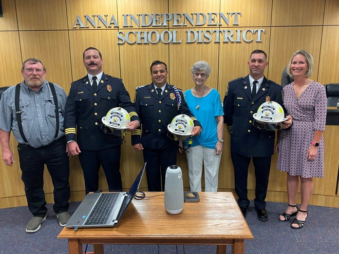 Anna FirefightersBryan Thomas (second from left), Chuy Eaton and Cody Nelson were joined by family members for a pinning ceremony celebrating their promotionsto battalion chief.