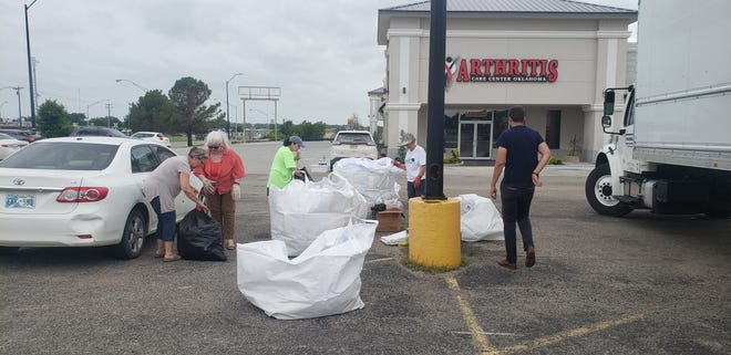 Volunteers help sort recycling at Ardmore's first recycling event on Saturday, June 26.