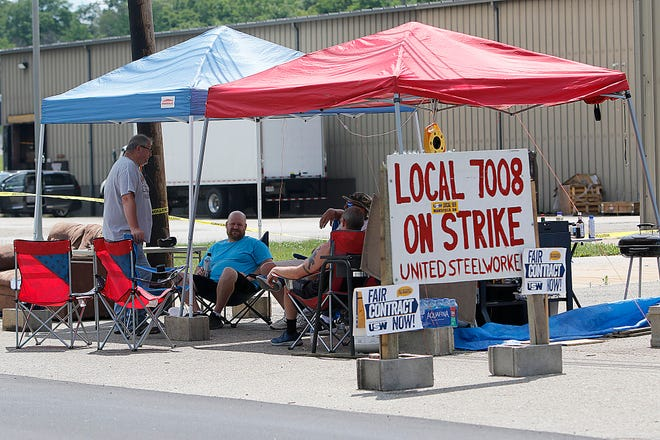 United Steelworkers Union 7008 members, shown here in June on strike at Custom Hoists in Hayesville, will return to work Monday.