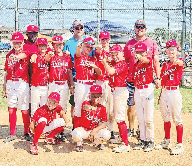 Bartlesville Patriots' players and coaches celebrate after winning the 11U USSSA state championship last month.