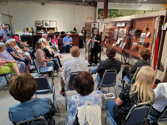 """Marjorie Herrera Lewis, author of the historical novel """"When the Men Were Gone,"""" speaks at the Brown County Museum of History Monday night. Lewis opened the Tylene Wilson exhibit at the museum."""