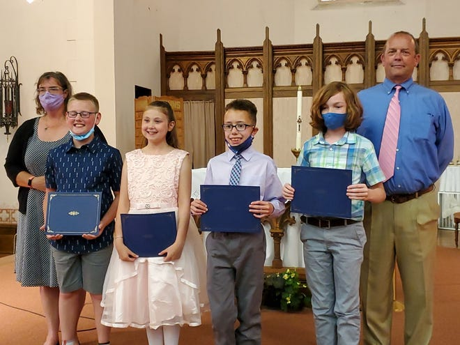 St. Michael's 5th grade graduates wowed us at their graduation ceremony and then enjoyed a nice reception hosted by the 4th grade parents and students.  May they carry their friendships and values into their 6th grade experiences. Flanked by Principal Debra Marvin and 5th grade teacher, Keith Prather.