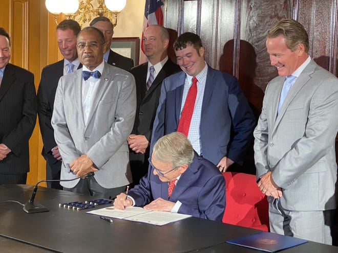 Ohio Gov. Mike DeWine signs House Bill 168, which will repay the state's federal unemployment loan and fund a number of water and sewer projects.