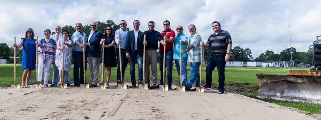 Lafourche school officials and others break ground Tuesday on the new Thibodaux Middle School.