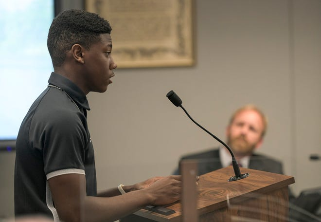 East Ridge High School student Tim Moses speaks at a Lake County School Board meeting Monday in Tavares. Moses, a football player for the Knights, spoke in defense of coach Martez Edwards before board members voted for his termination after an investigation revealed he falsified his employment application with the district. [PAUL RYAN / CORRESPONDENT]