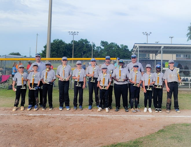 Leesburg's 12U Cal Ripken All-Star team poses for pictures earlier this month after winning the District 10 championship. The team begins play Thursday in the state championship tournament in Palm Beach Gardens. [COURTESY / TRAVIS RIMA]
