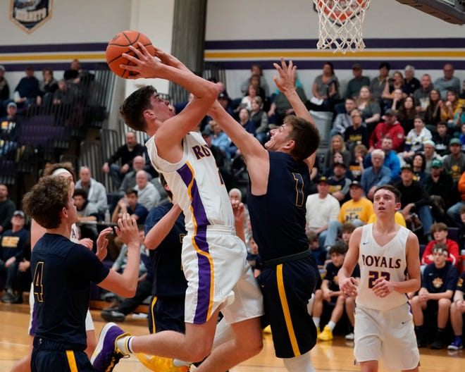 Blissfield's Ty Wyman goes up for a shot while defended by Erie Mason's Joey Liedel during the 2019-20 season.
