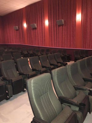 The new rocker seats installed in auditorium 7 at Lexington Cinema are wider than the older theater seats and the armrests move up and down. There are six feet of distance between rows.