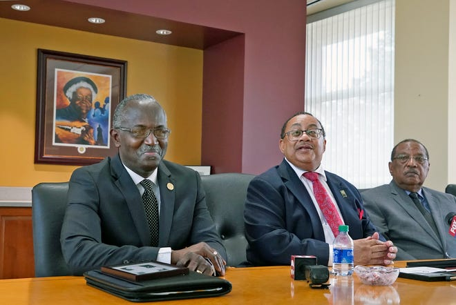 Bethune-Cookman University Interim President Hiram Powell, board Chairman Belvin Perry and board member Pete Gamble announce the signing of a $108 million loan that resolves a dorm deal that nearly forced the Daytona Beach school to close.
