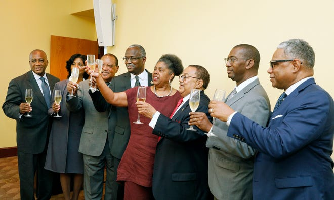 Bethune-Cookman University officials make a toast while celebrating a settlement, Tuesday, June 29, 2021.