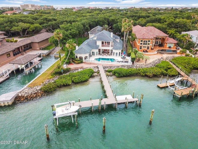 This boat lover's dream estate is nestled on one-and-a-half acres in coveted Ponce Inlet. It has 130 feet of Intracoastal Waterway frontage, a deep-water dock, six en-suite bedrooms, a home theater, a glass bar and a seven-car garage.