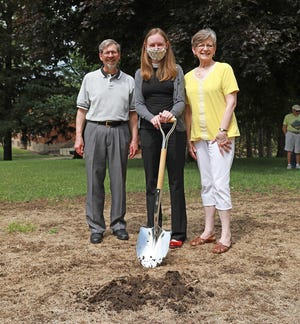 Pictured from left at the future site of a labyrinth on campus are 1975 Monmouth College graduate Jon Dahl, Monmouth Associate Chaplain the Rev. Jessica Hawkinson, and Dahl's wife, Barbara.