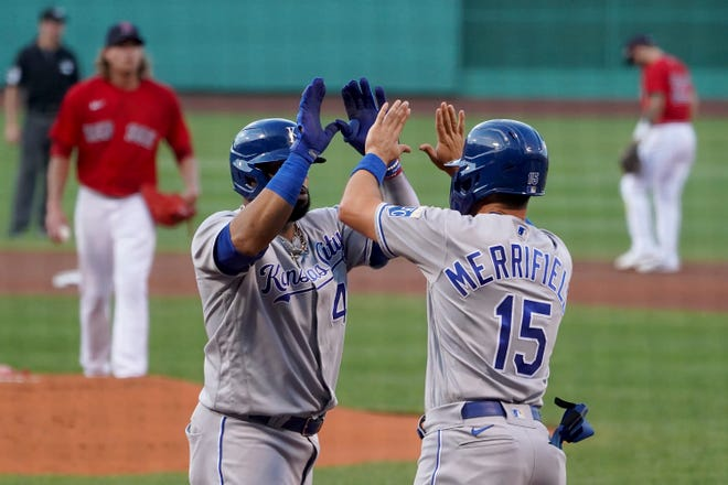 Royals first baseman Carlos Santana (41) is congratulated by teammate Whit Merrifield (15) after hitting a three-run home during the first inning of Monday's game against the Boston Red Sox at Fenway Park. The Royals built a 5-1 lead but the Red Sox rallied for a 6-5 win.