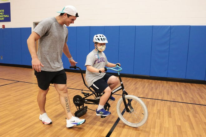 Jacksonville Jaguars kicker Josh Lambo( guides 10-year-old Drew Crass during Tuesday's iCan Bike Camp at the North Florida School of Special Education. Lambo is sponsoring the camp's first appearance in Jacksonville.