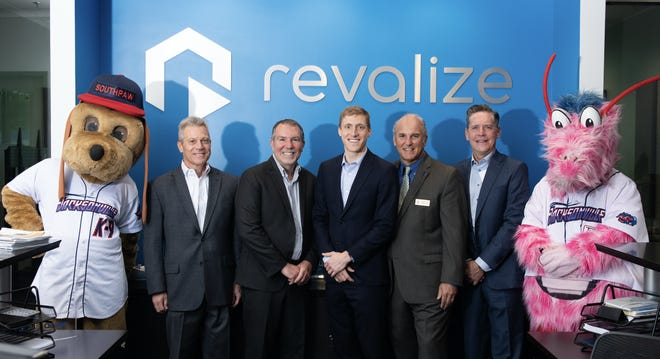 City and company officials announce that firm Revalize will have its headquarters at8800 W. Baymeadows Way andexpand thefacilities.