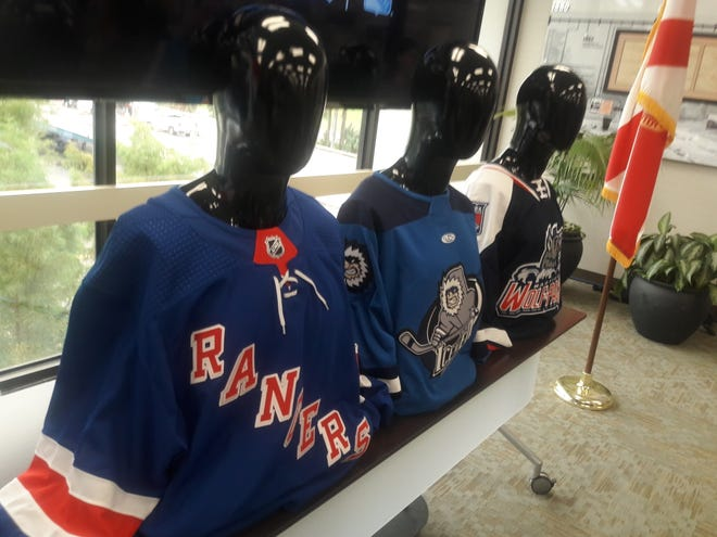 Hockey sweaters for the New York Rangers, Jacksonville Icemen and Hartford Wolf Pack line up at Jax Chamber for the Icemen's affiliation announcement on June 29, 2021. [Clayton Freeman/Florida Times-Union]