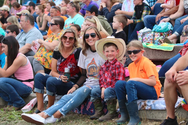 Heather Richter, Kaitlyn Wollman, Nash Richter and Elanya Kling are all smiles in the roaring crowd.
