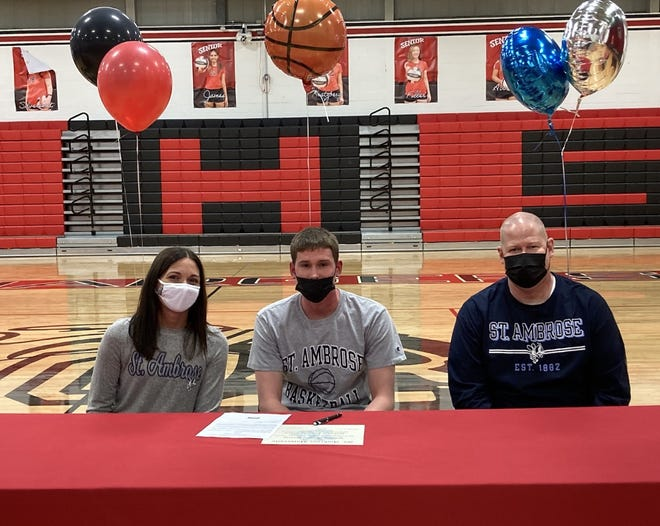 Will Dunlap, center, wrapped up his senior year at Orion High School by signing a letter of intent on Friday, May 7, to play basketball at St. Ambrose University. His parents are Taryn and Mike Dunlap.
