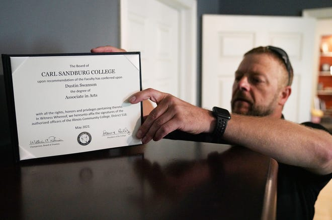 Dusty Swanson places his Carl Sandburg College diploma atop a dresser in his Henderson home. Swanson first started at Sandburg in 1998 and returned in 2019. He graduated in May with his Associate in Arts.