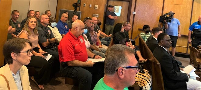 Firefighters packed city council chambers Monday.