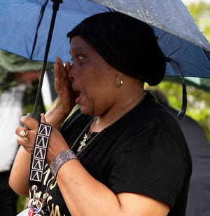 Gloria Jennings wipes a tear as she listens to Housing Assistance Corp. officials talk about the joys of home ownership during a groundbreaking ceremony held Tuesday.