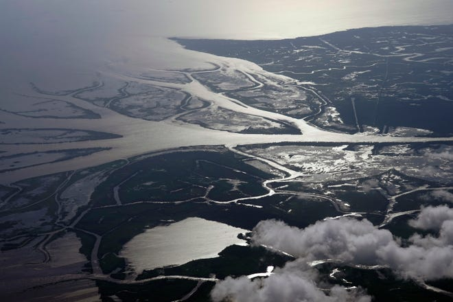 The Wax Lake Delta in the Atchafalaya Basin is seen from 8,500 feet in St. Mary Parish, La. Tuesday, May 25, 2021. In geological time, young means thousands of years. On that scale, Louisiana's Wax Lake Delta is taking its first breaths. (AP Photo/Gerald Herbert)