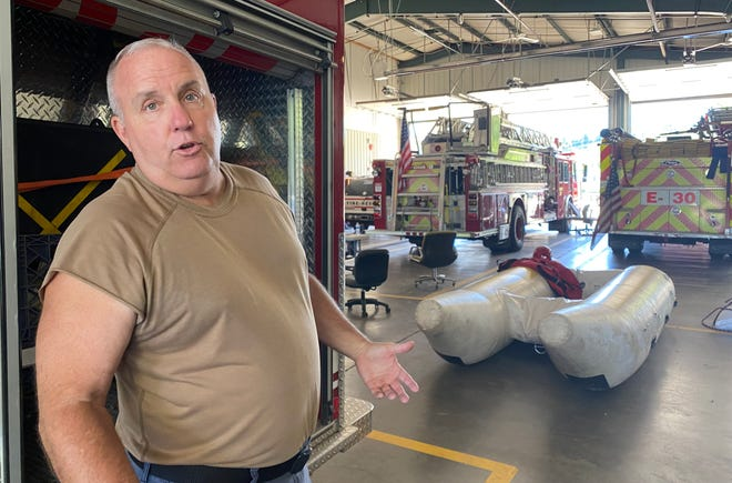 Fire Chief Rick Gobble said the raft behind him is about 20 years old.