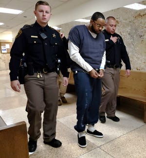 Lubbock County Sheriff's deputies on Tuesday escort Justin Jackson out of the 364th DIstrict Court where he pleaded guilty to a count of murder in the August 2018 stabbing death of his girlfriend.