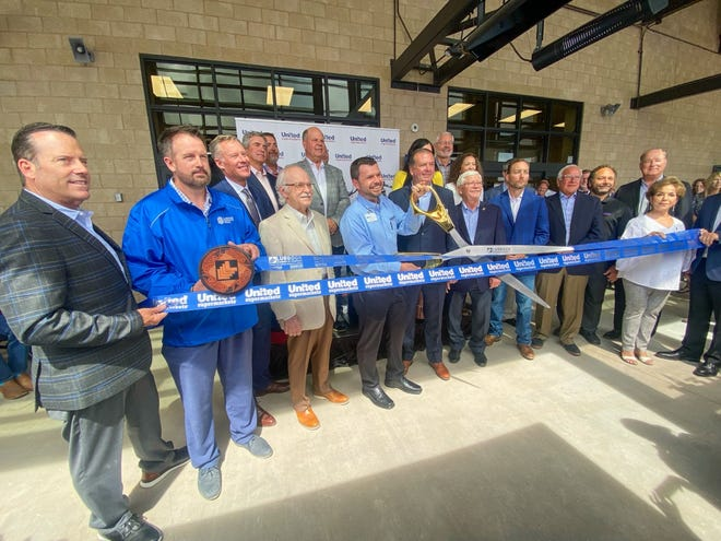 Eric Steinfath, director of Lubbock's newest United Supermarkets store at 114th Street and Slide Road, cutting the ribbon for a grand opening event on Tuesday.