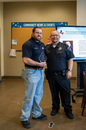 Officer Cale Breshears is presented the 2020 Thomas Engells Memorial Award for Excellence from the Texas Association of College and University Police Administrators by Mike Smith, LCU's chief of police and director of Public Safety.