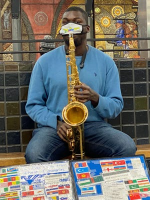 Jonte Samuel plays the saxophone in the Park Street MBTA station. He's one of the talented musicians who entertains people coming and go in the station. Jonte plays music from many different countries.