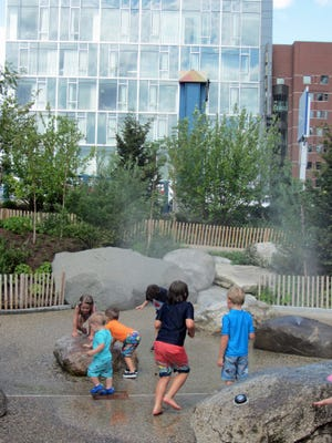 Kids have a great time with the water sprays at the new Martin Richard's Park.