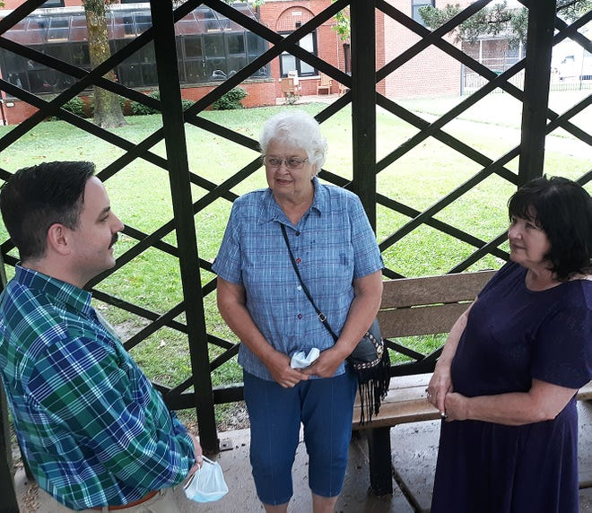 Dr. Chad Neal, a mental health professional at the Eisenhower VA Medical Center, visits with Donna Bacon and Kim Brown. Their husbands experience symptoms of post-traumatic stress disorder, and particularly struggle during Fourth of July celebrations.