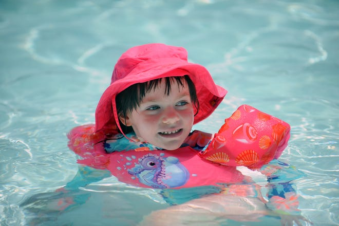 Everly Rice, 5, enjoys the heat wave in the Milford Town Pool at Fino Field, June 29, 2021.