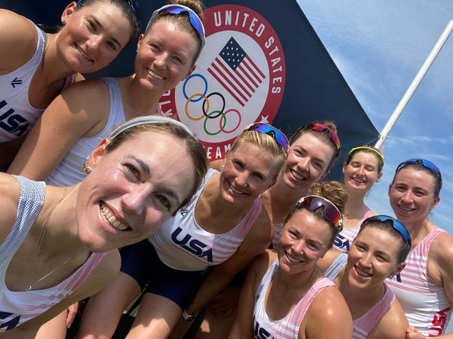 Two-time Olympic gold medalist Meghan Musnicki, (fourth from left) is seen with fellow athletes competing in the women's eight rowing competition at the summer Olympics in Tokyo that begin this week.