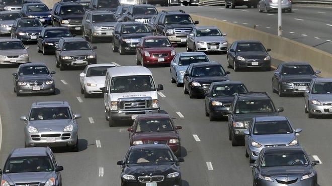 Traffic advances along the Massachusetts Turnpike in Boston.