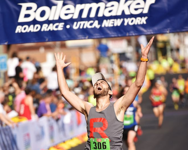 Jordan Angerosa, of Saratoga Springs, crosses the finish line at the 2018 Boilermaker Road Race. Showcasing our area to thousands of visitors is a great way to keep building on the region's success.