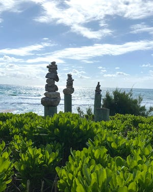 Stones are stacked atop piers near the beach at the South End of Palm Beach.