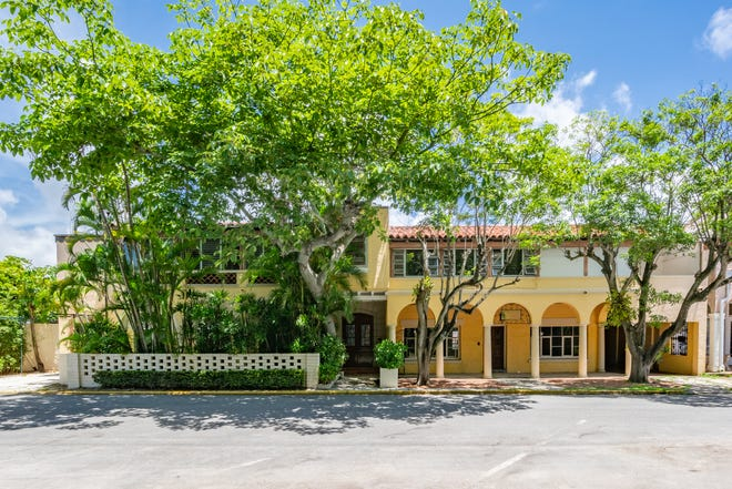 This building at 206 Phipps Plaza, which served for years as the home and office of the late Palm Beach architect John L. Volk, has been listed, with town-approved renovation plans, at $12 million. The property is on the north side of Phipps Plaza, a designated historical district.