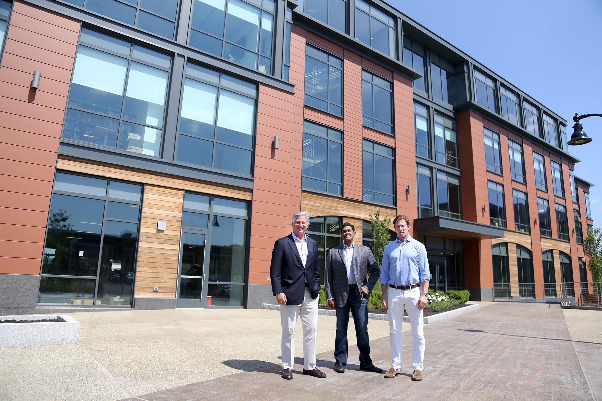 Developer Michael Kane, left, architect Haril Pandya and developer John Kane are making progress on their Maplewood Avenue building in Portsmouth.