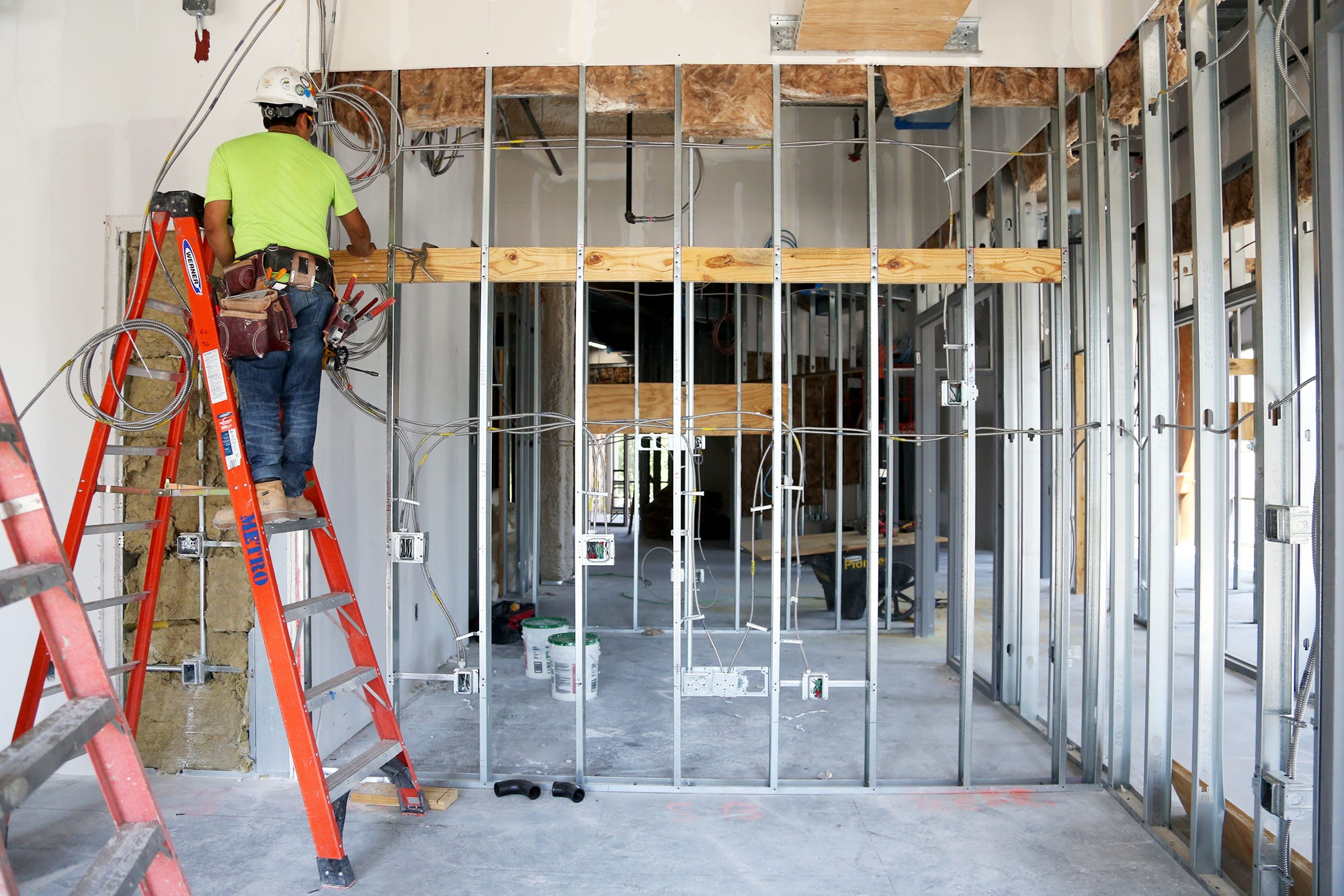 Construction workers make progress on the inside of the building at 111 Maplewood Ave. in Portsmouth.