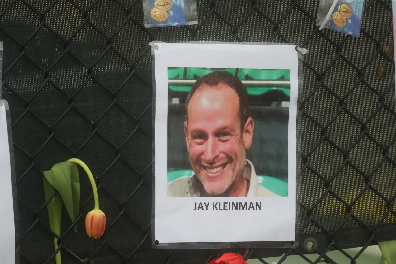 Shown is Jay Kleinman (or possibly Jay Kleiman). Posters of some of the people missing from the Champlain Towers south condo collapse in Surfside, Florida, were photographed on Monday, June 28, 2021 at the memorial fence near the scene.